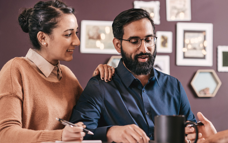 Couple receiving financial planning advice