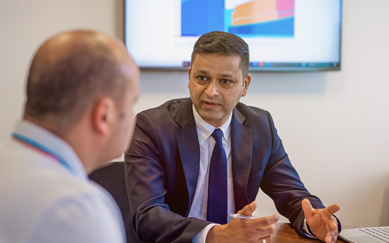 Amit Mittal giving financial planning advice to a client