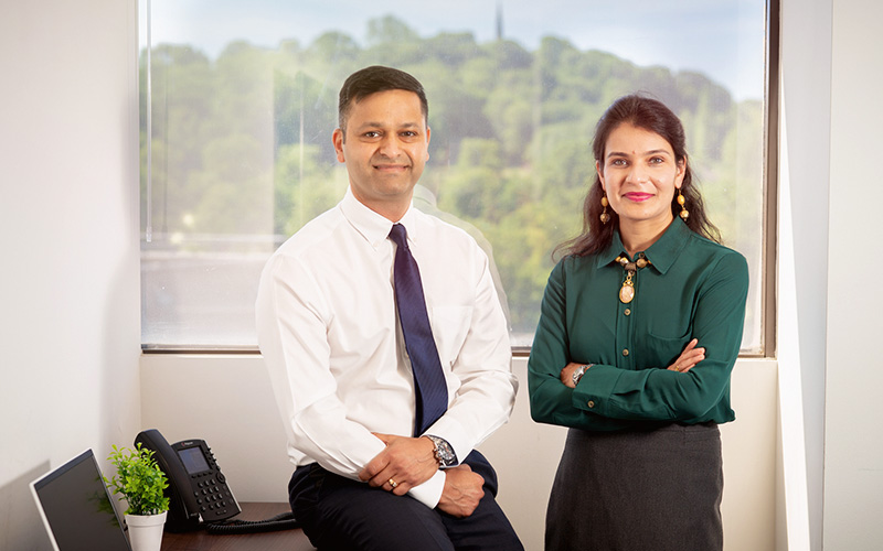 Amit with wife Shweta in their Harrow office