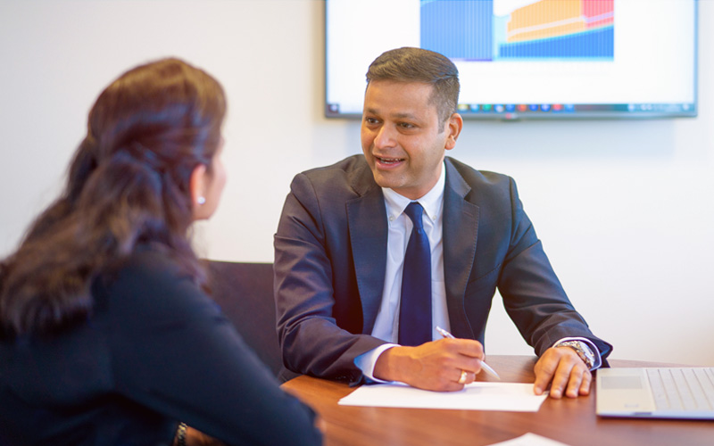 Amit Mittal offering financial planning advice to client