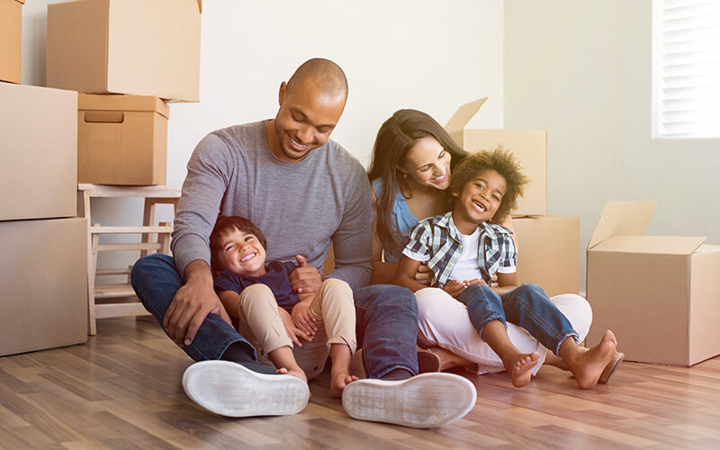 Mortgage planning - Happy family in new house