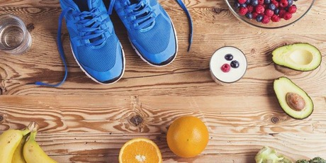 food on a wooden board and some blue trainers