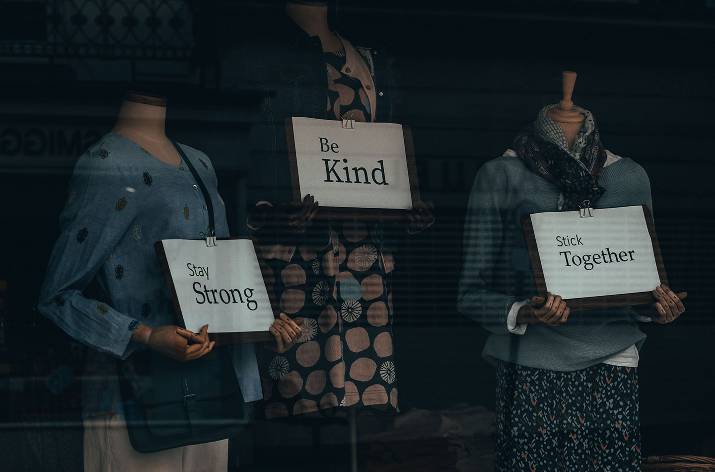 mannequins holding supportive messages during pandemic