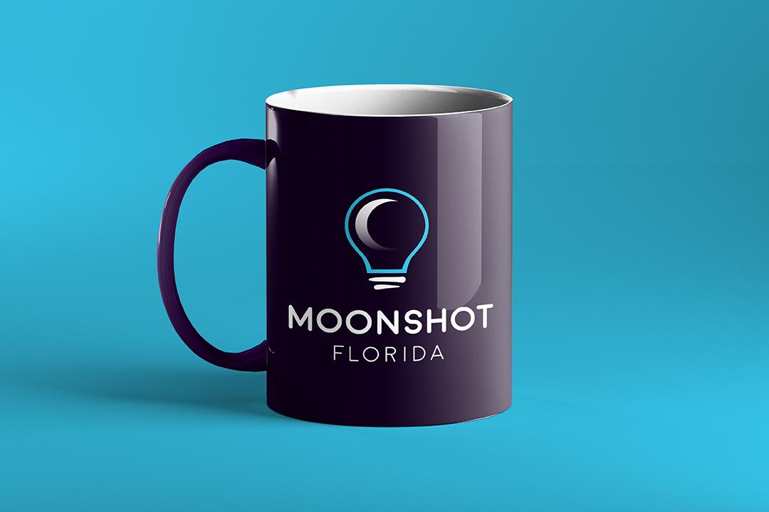 Promotional mug branded to Moonshot Night.