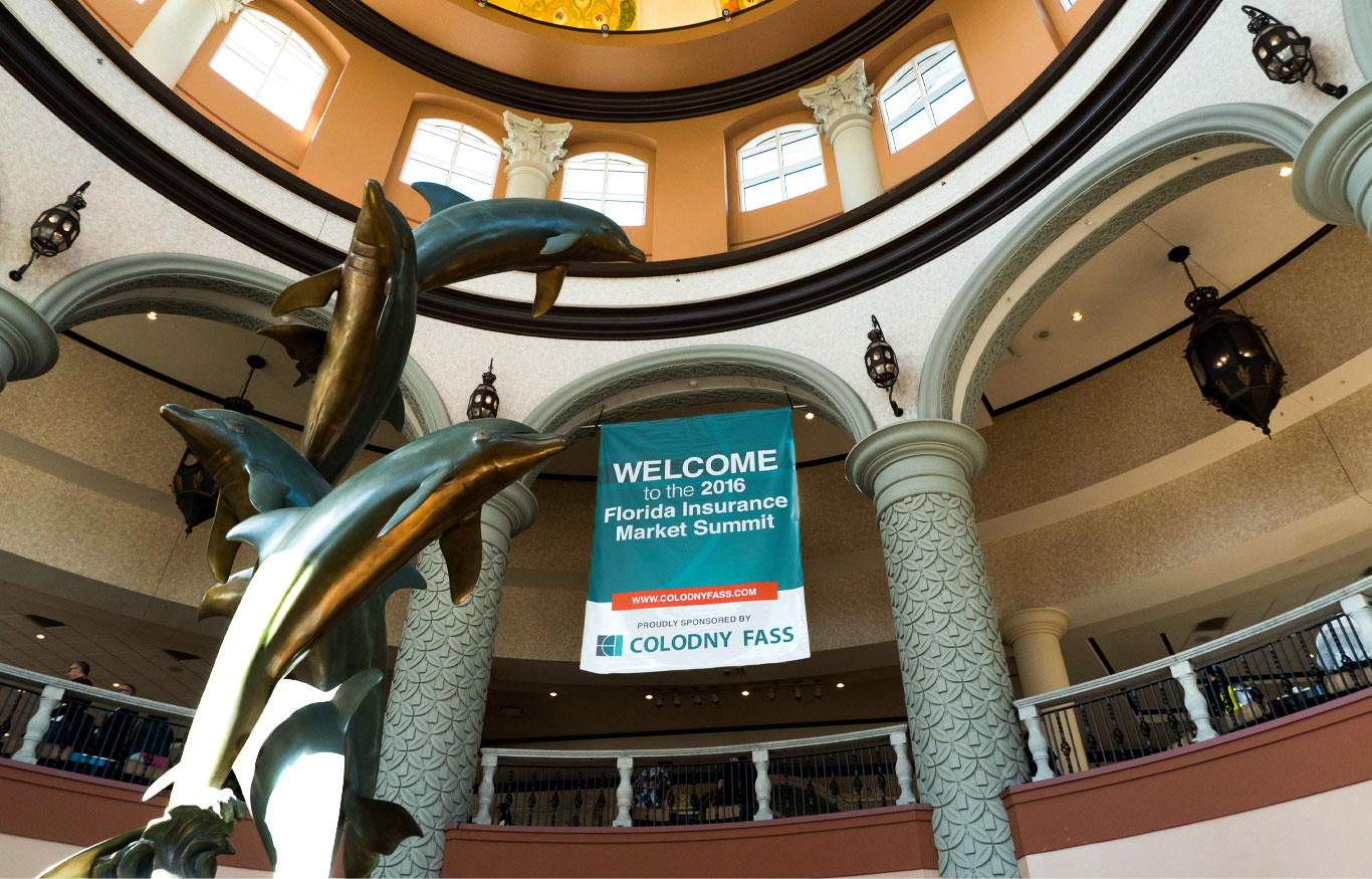 A large conference banner hanging in a beautiful rotunda at the Gaylord Palms in Kissimmee, Florida.