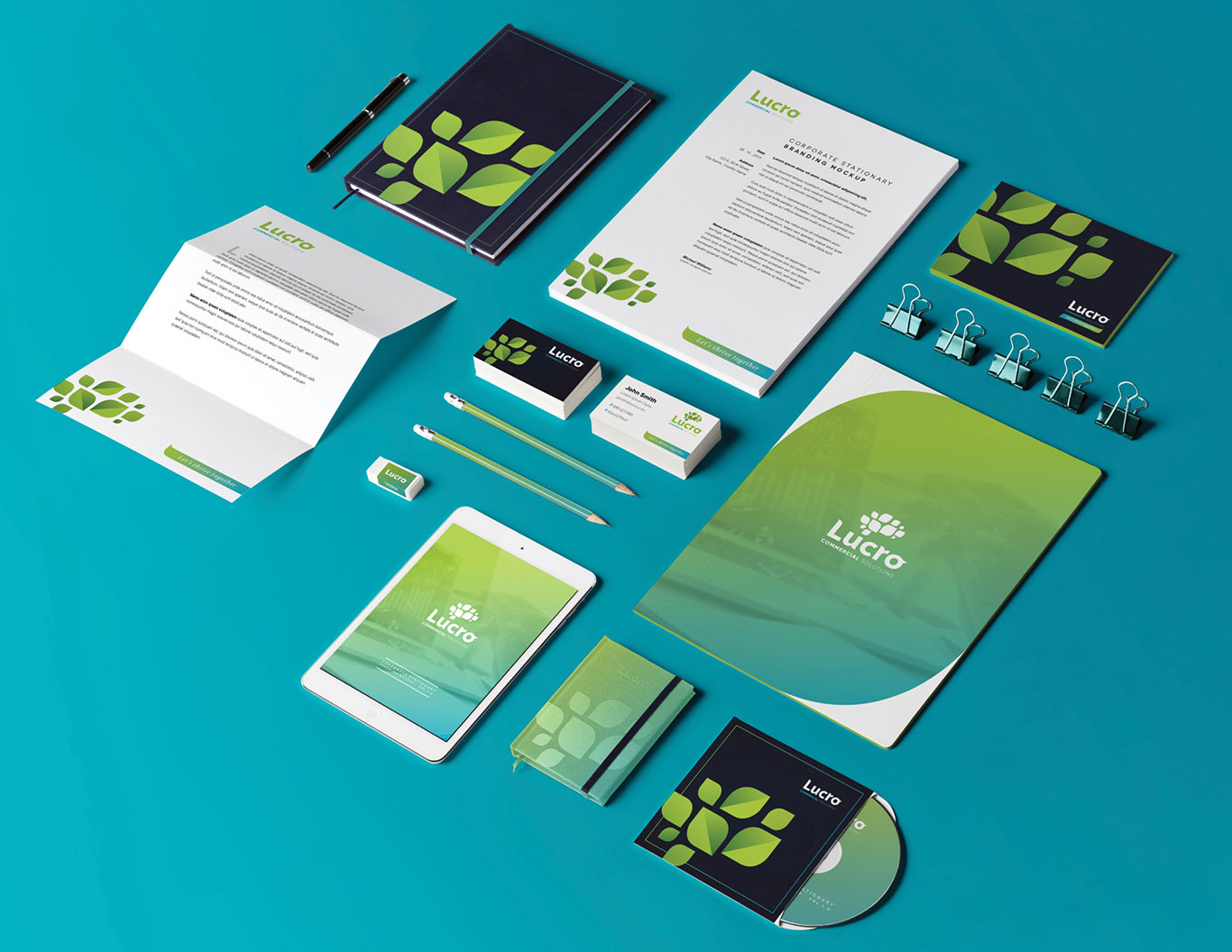 Blue and green stationary and other corporate materials designed for Lucro Commercial Solutions.