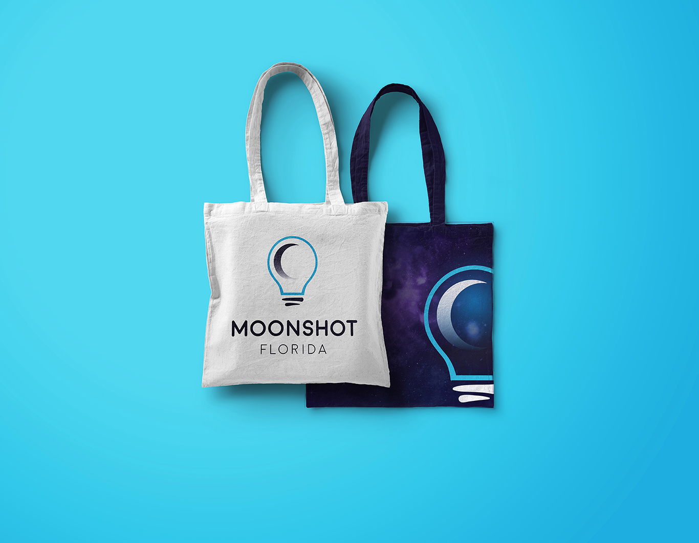 Two tote bags branded to Moonshot Night.
