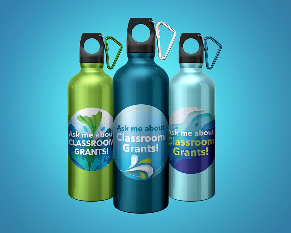 Three stainless steel water bottles branded to the Community South Credit Union Splash ad campaign.