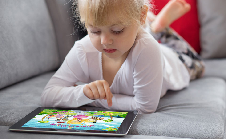 Young girl reading the children's book, Lauren's Kingdom, on a digital tablet.