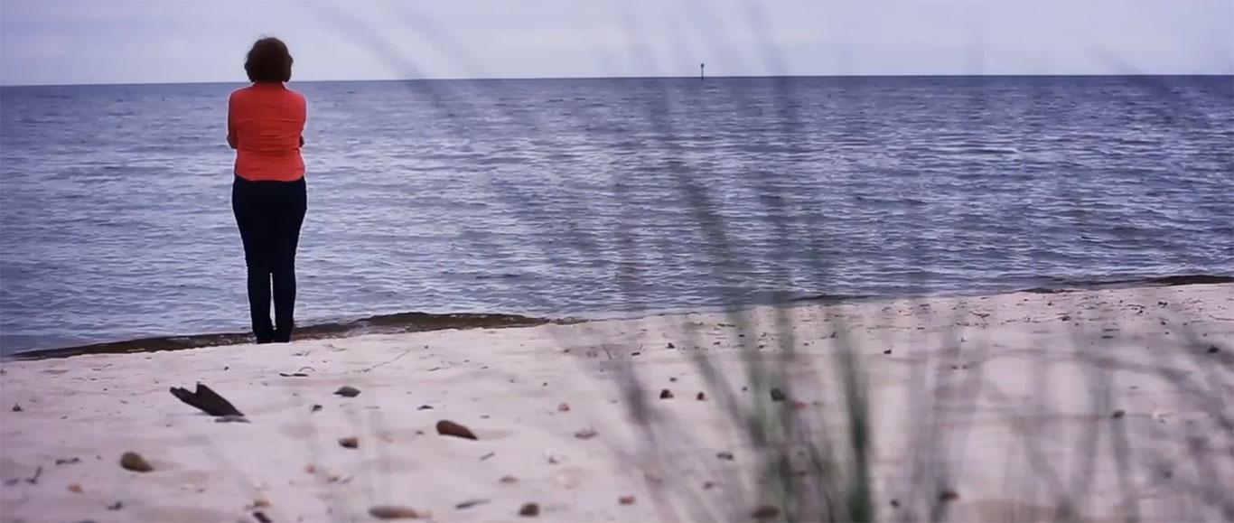 woman walking along the seashore