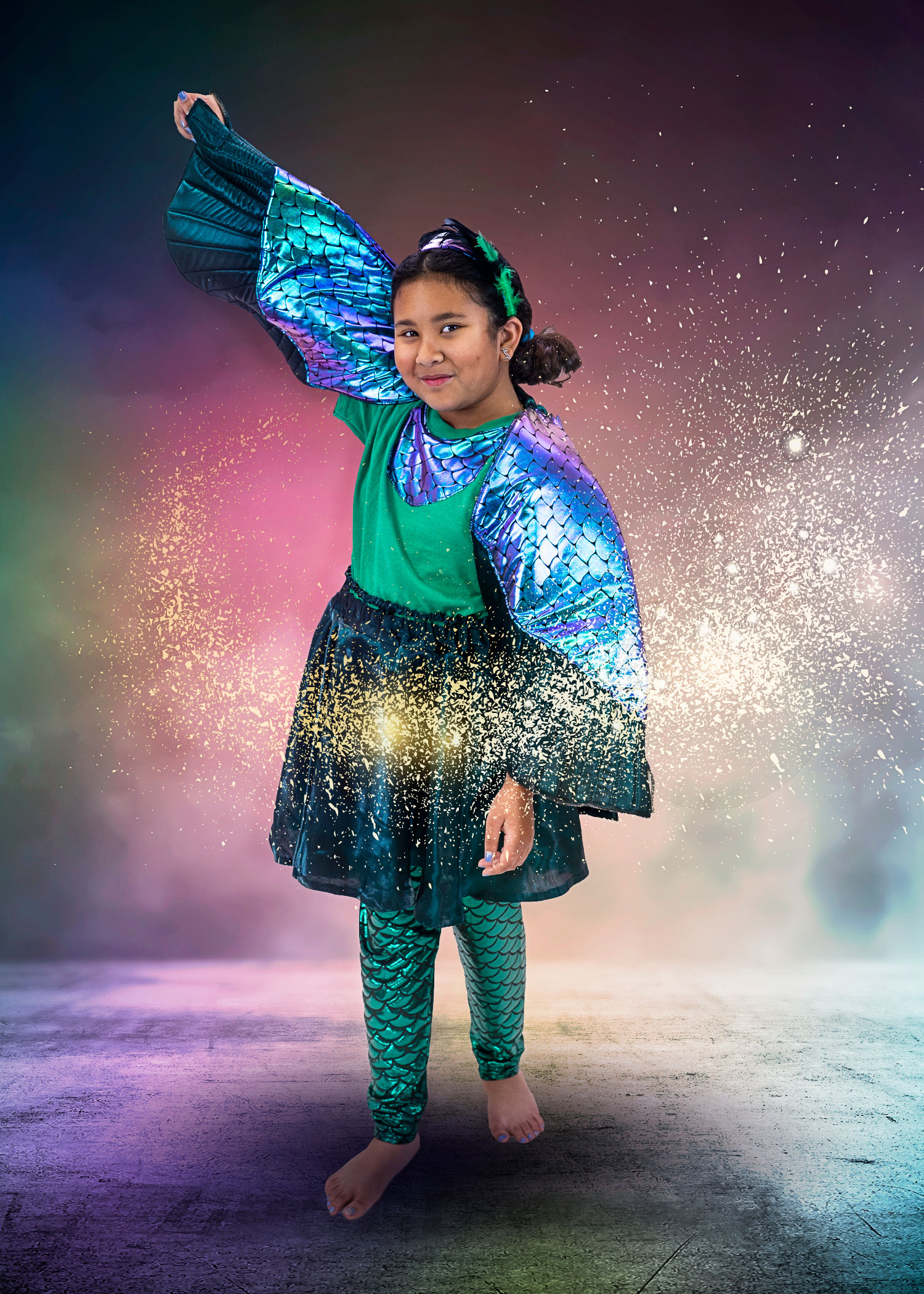 making light student in peacock costume