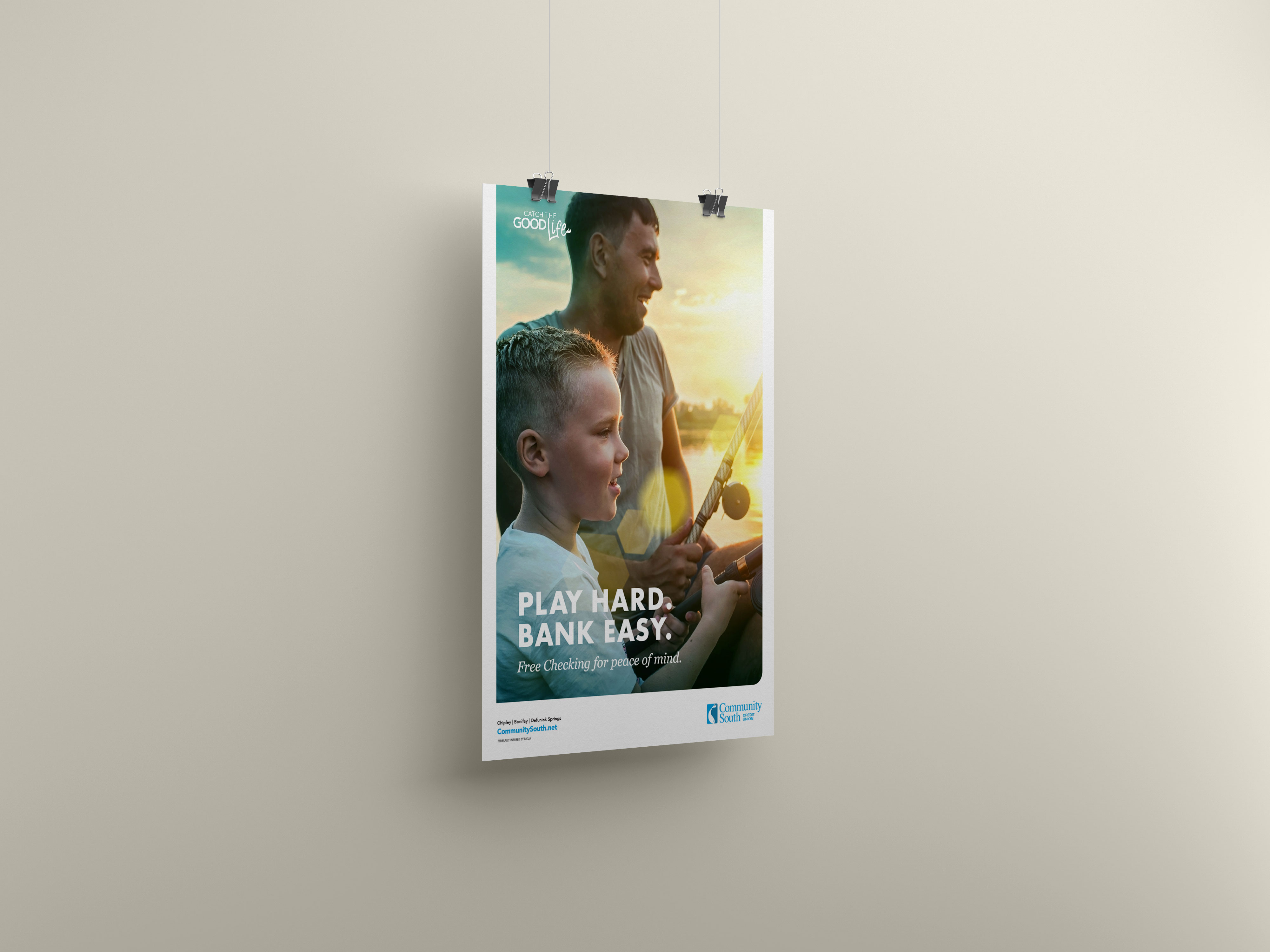 Poster hanging from wall with father and son fishing