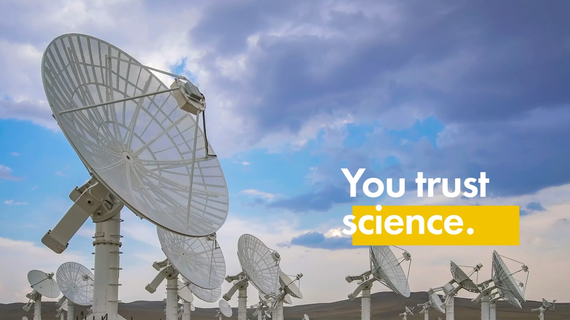 """Screenshot from commercial of a satellite dish with words """"You trust science"""""""