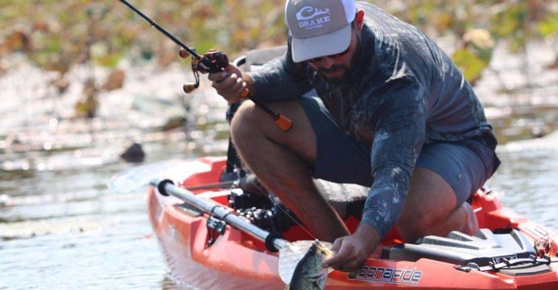 Kayaker catching fish.