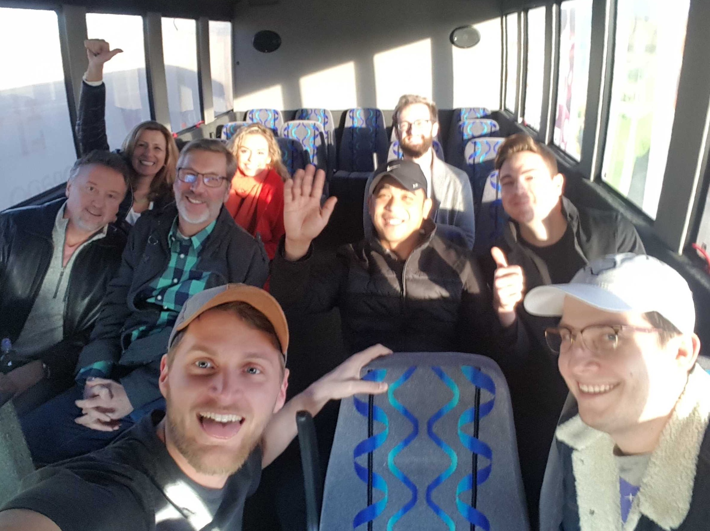 team on a bus ride to annual meeting