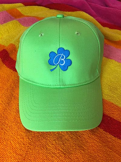 green had with blue clover embroidery