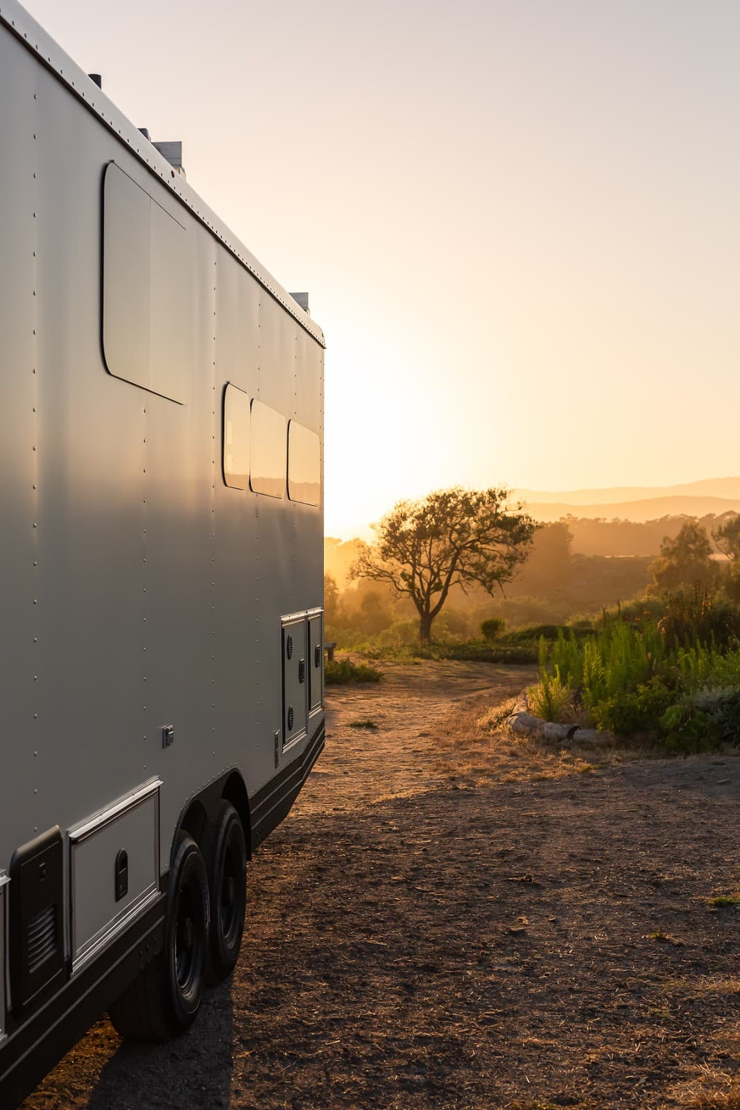 Living Vehicle Travel Trailer Parked With Sunset