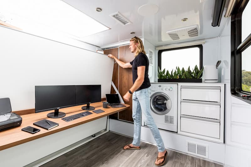 look at washer and dryer inside a luxury rv