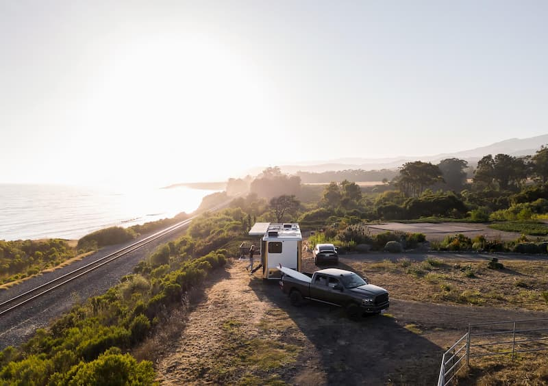 luxury rvs getting towed with sunset