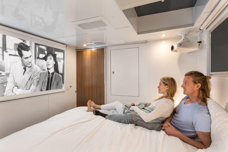 luxury camper trailer bedroom couple on bed