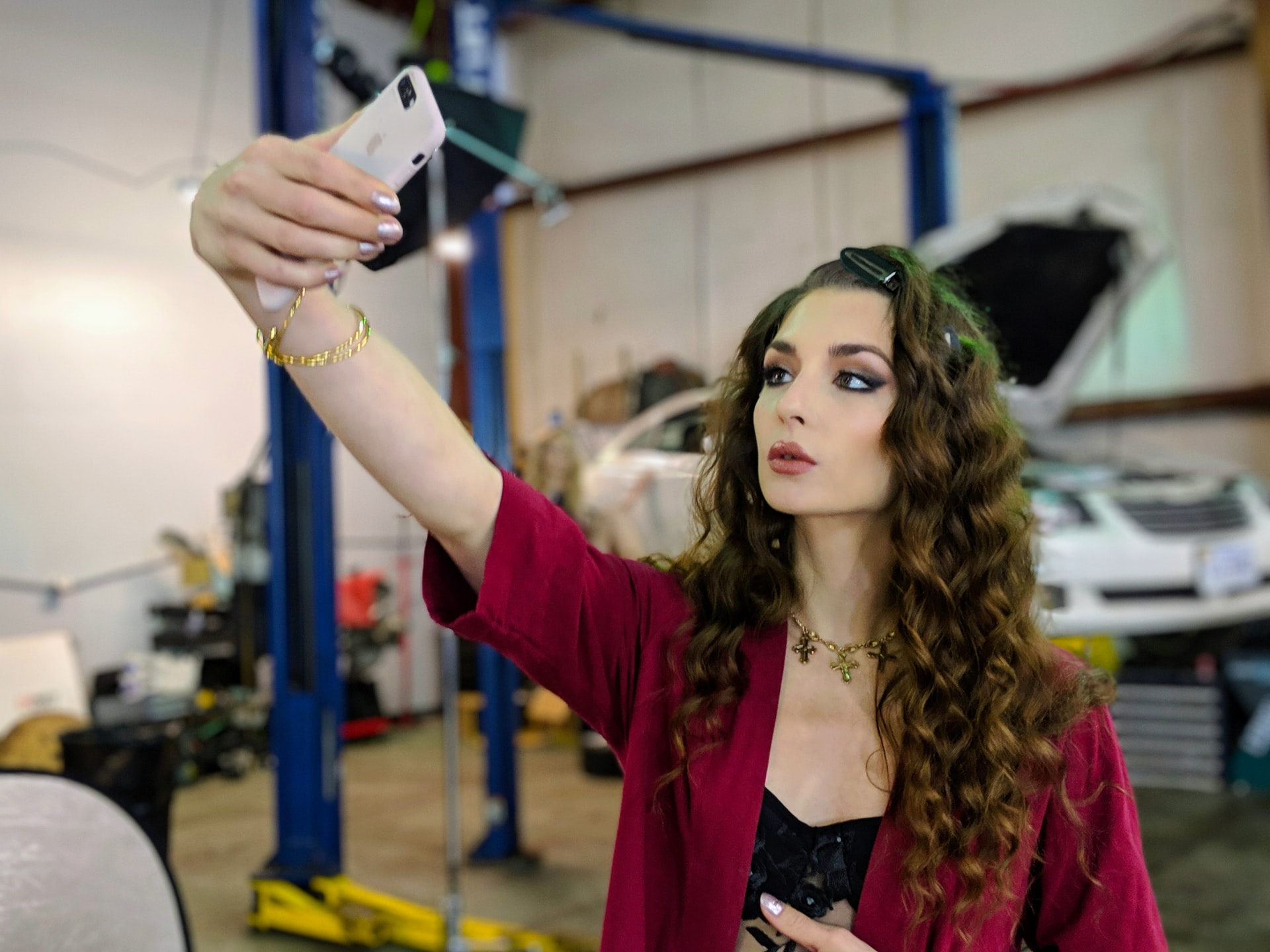 A beautiful, long-haired woman taking an Instagram selfie
