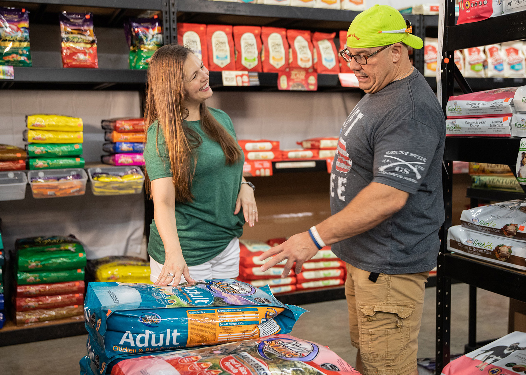 man pointing to product in pet supply store