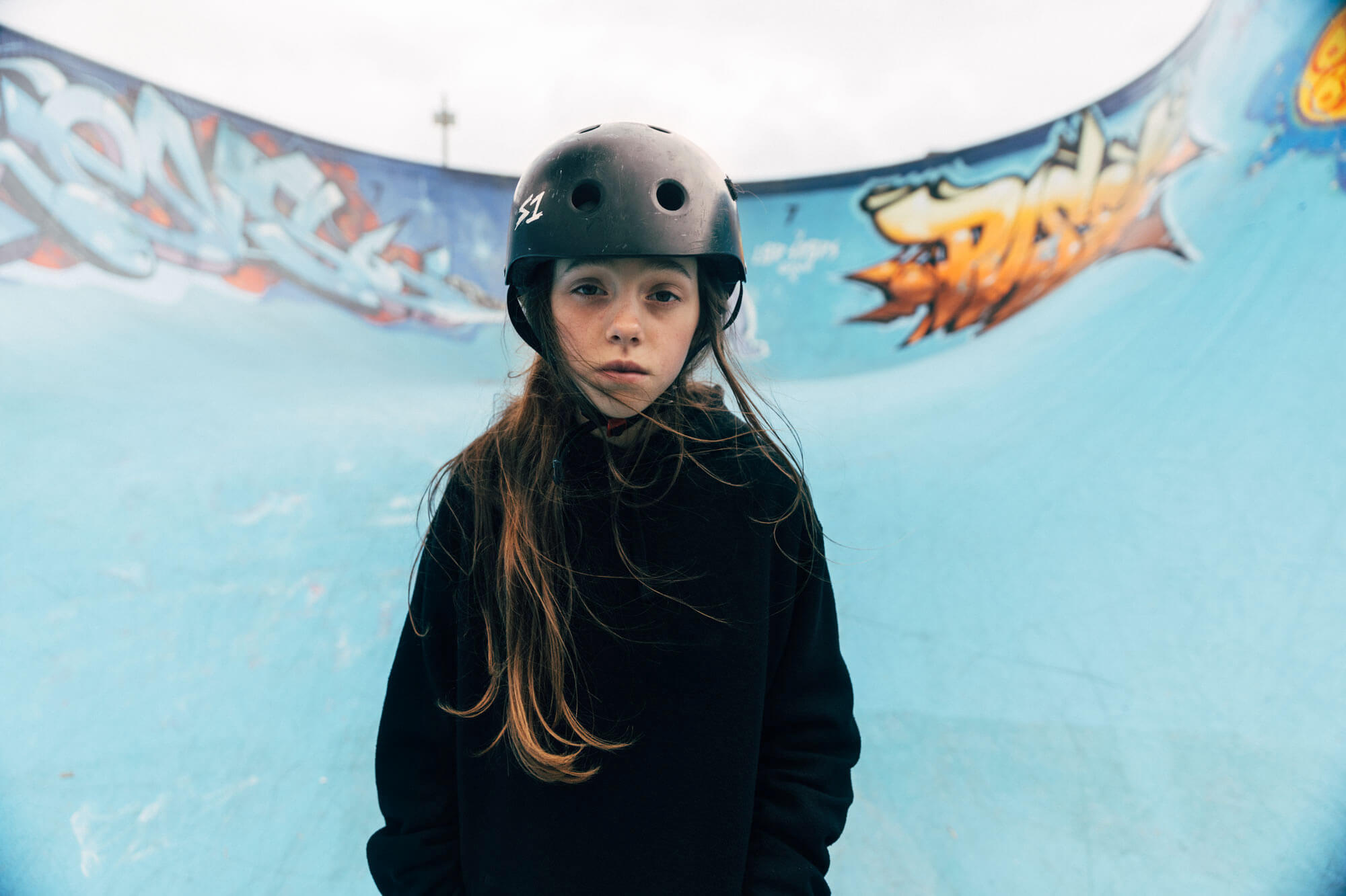 Young female skateboarder at skatepark