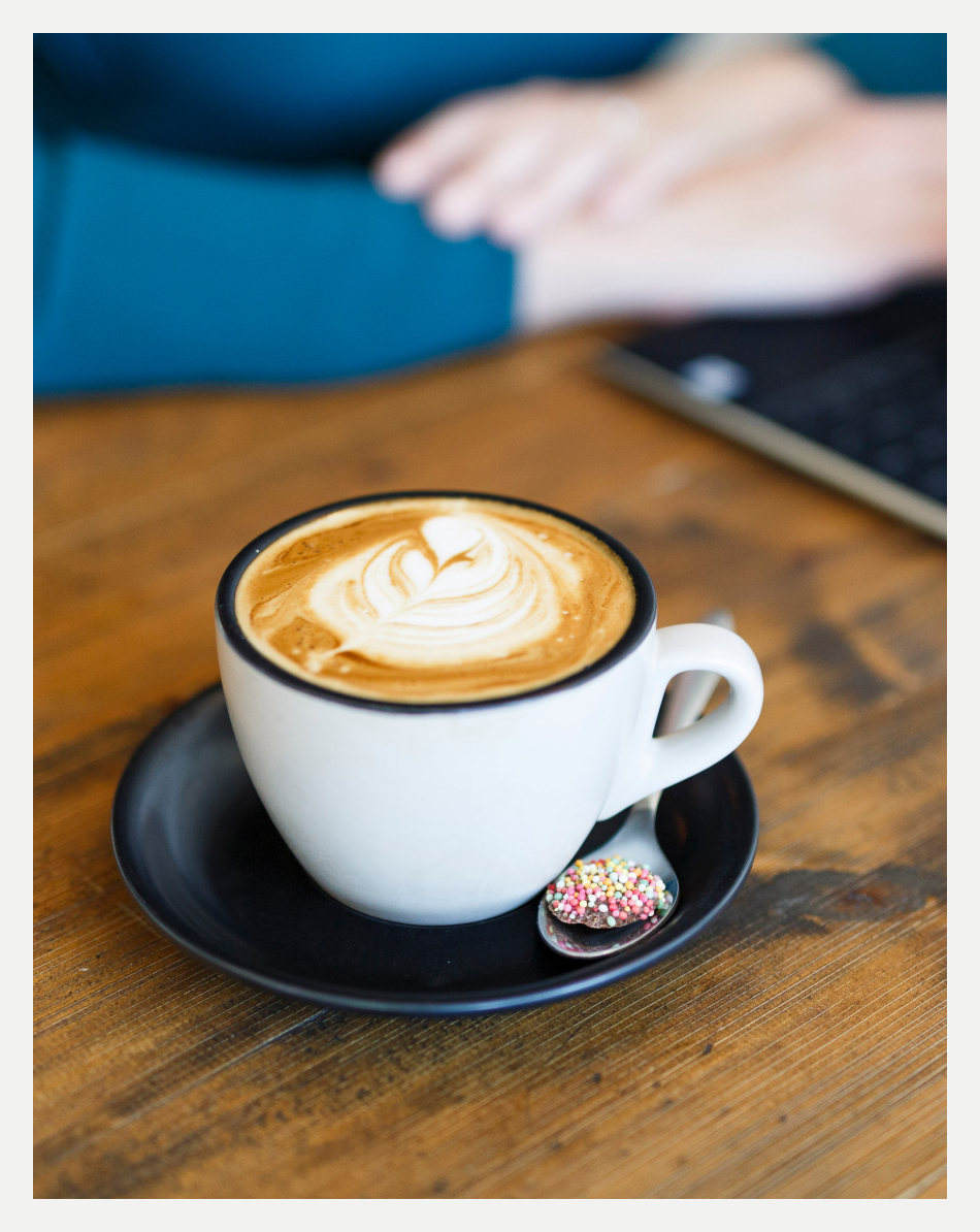 An image of a cup of coffee with Melissa Wright in the background