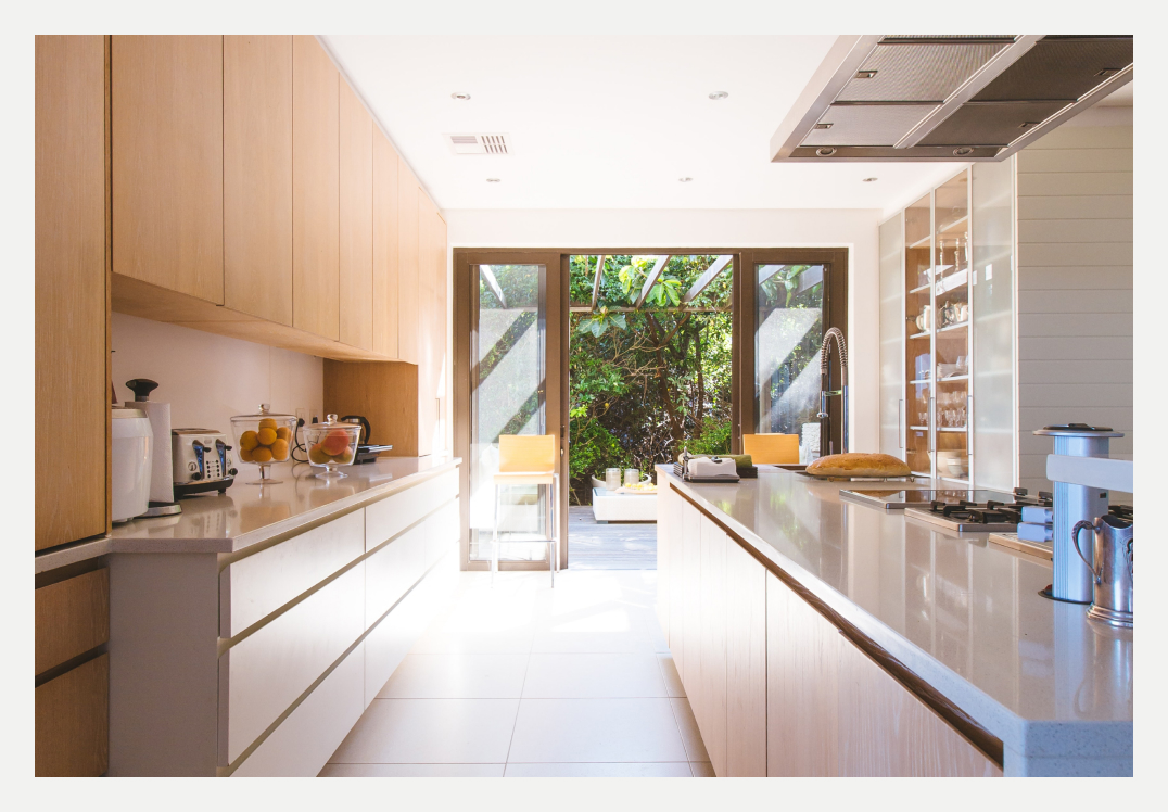 image of renovated kitchen looking out to courtyard