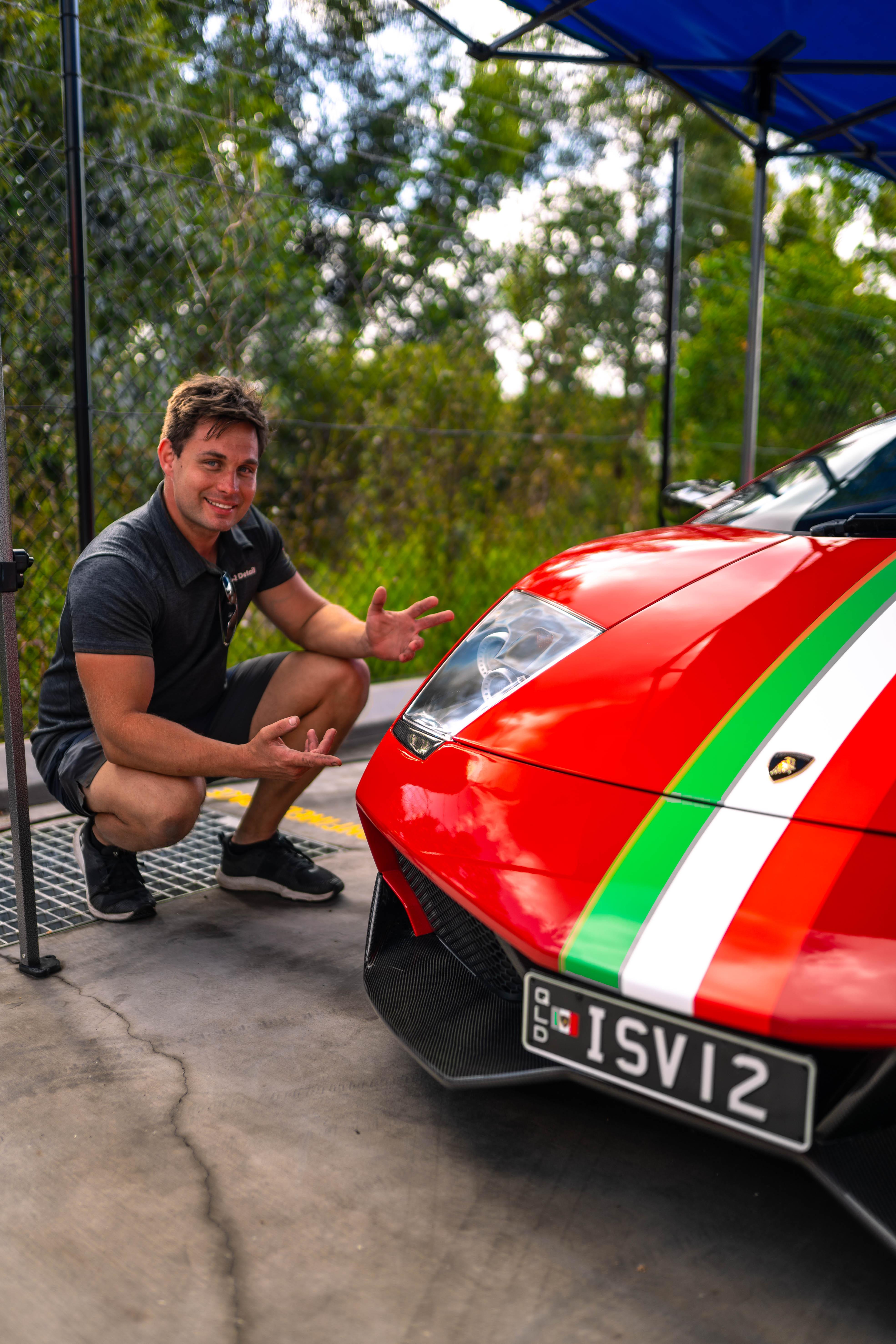 Image of David Vertesi infront of a vehicle he has been detailing