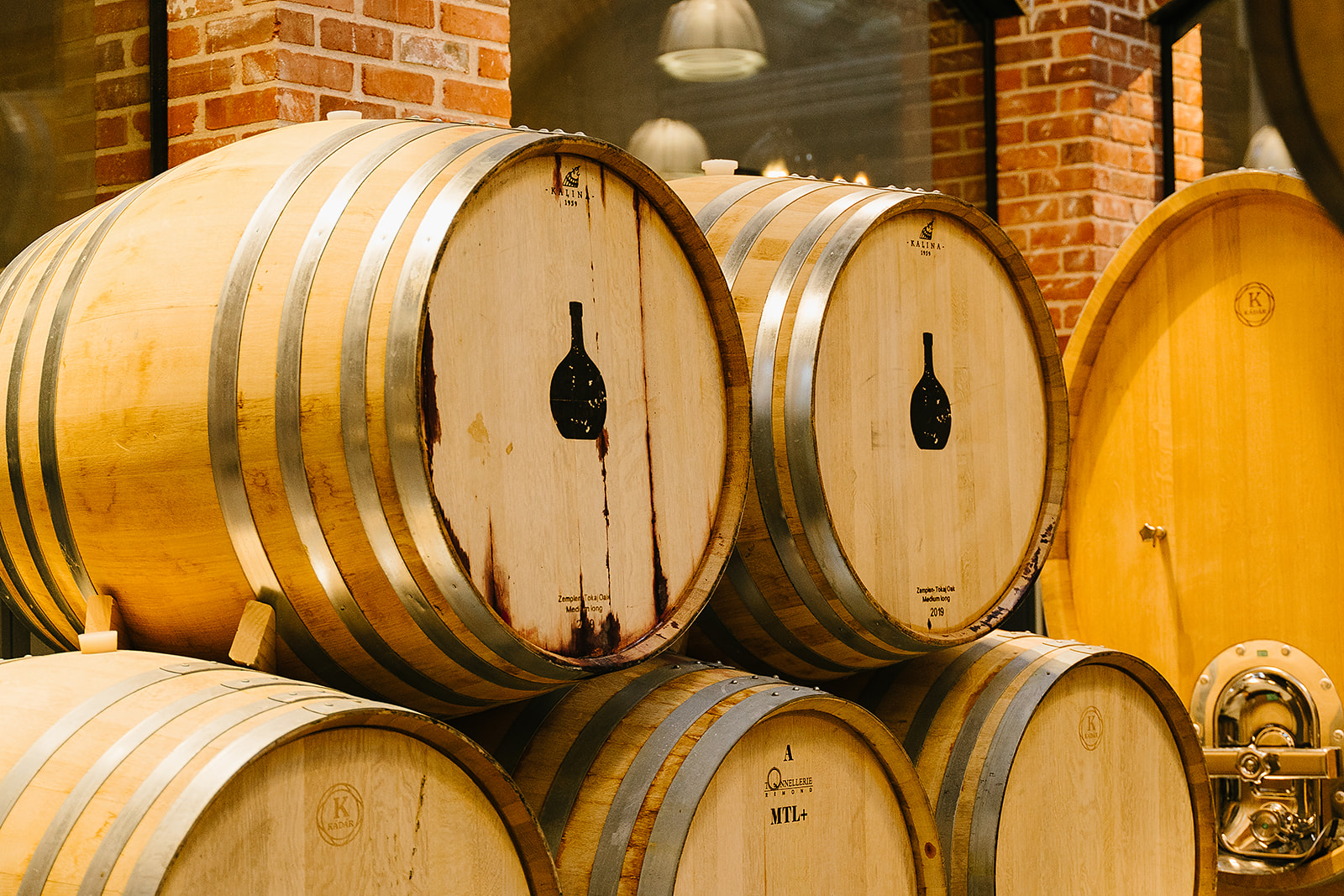 Large wine barrels stacked on top of each other with the Carboy Winery logo printed on them.