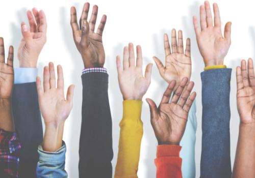 volunteer hands raised