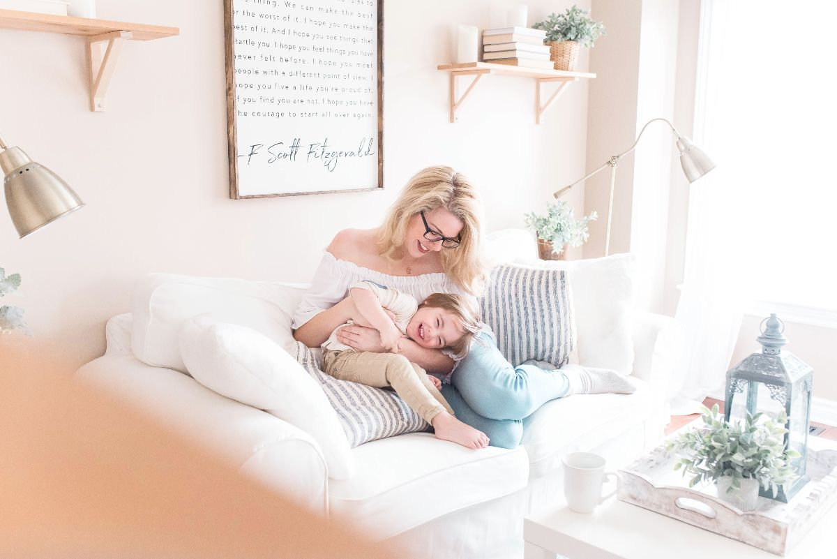 Mother tickling kid
