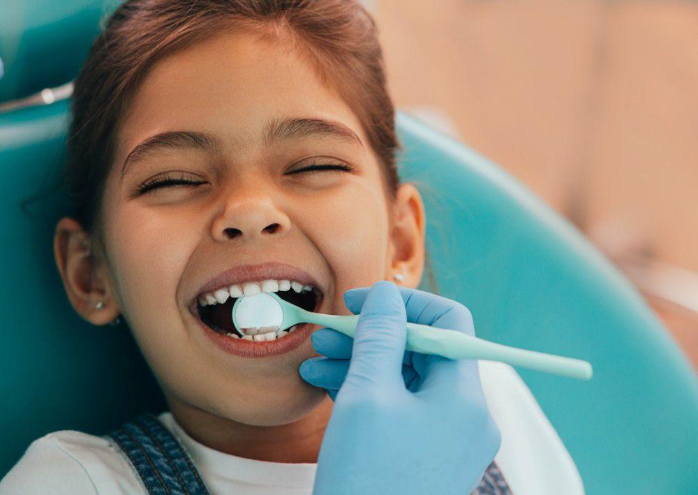 Girl smiling during her dental visit