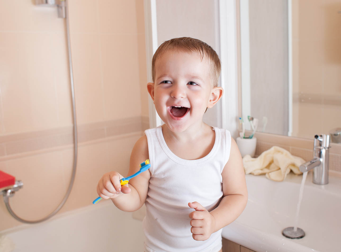 Boy about to brush his teeth