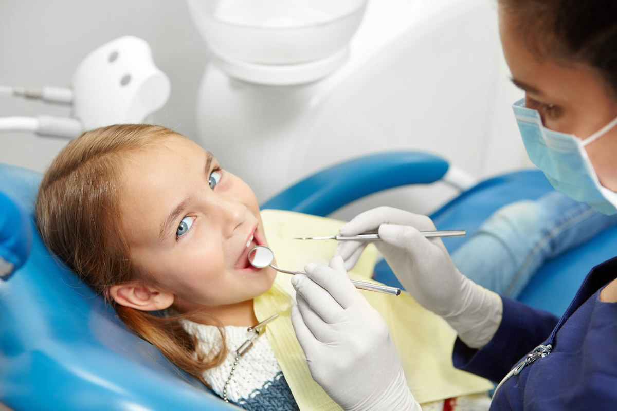 Girl being prepped for tooth extraction