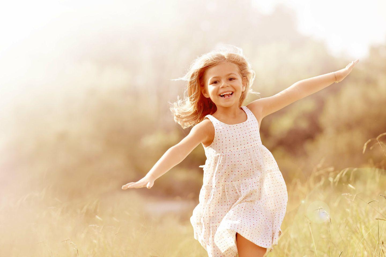 Girl running through a field