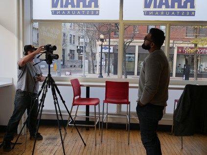Obby Khan recording his testimonial interview with a camera person for the Dynacare4Diabetes campaign