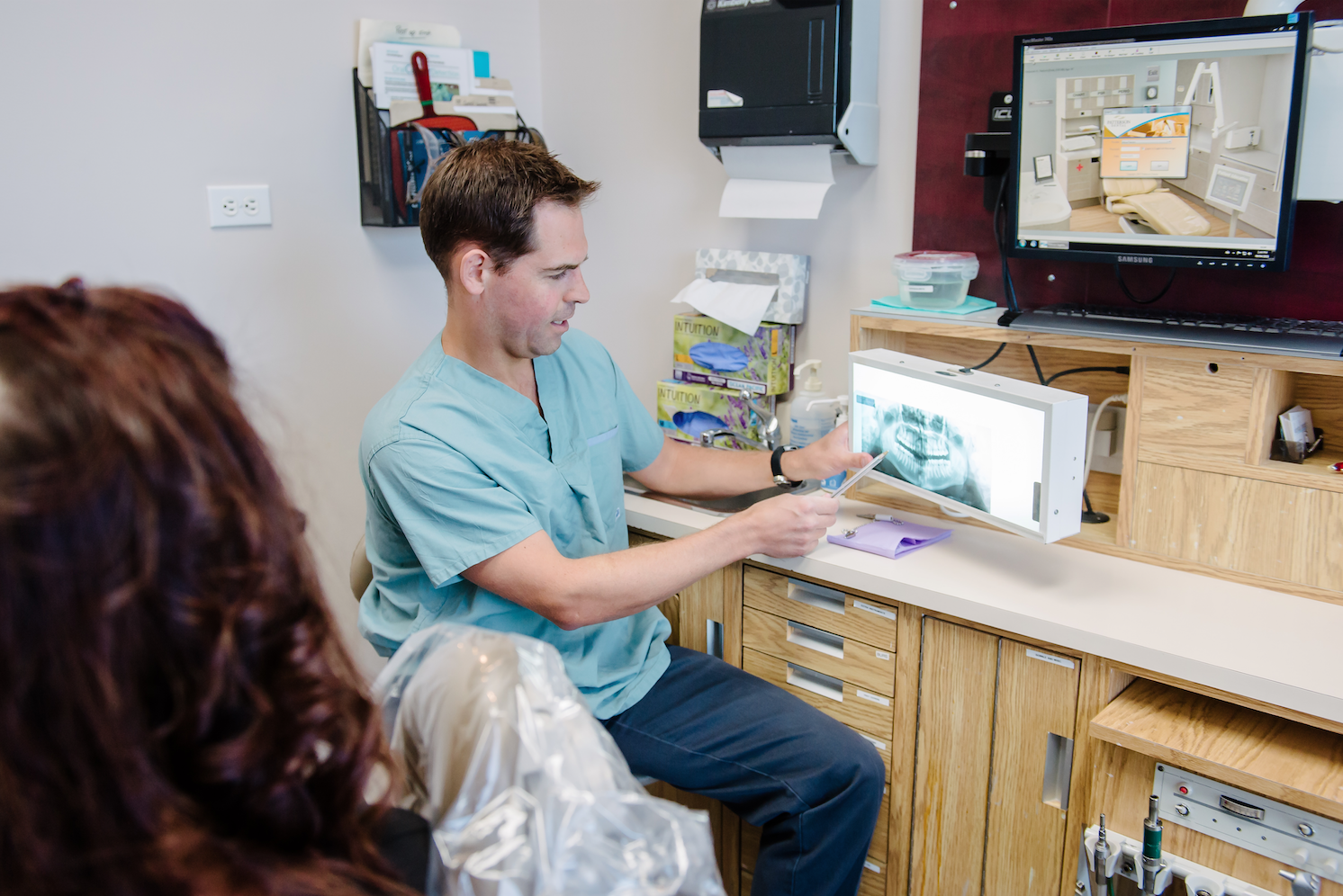 Dentist and patient in a dental clinic