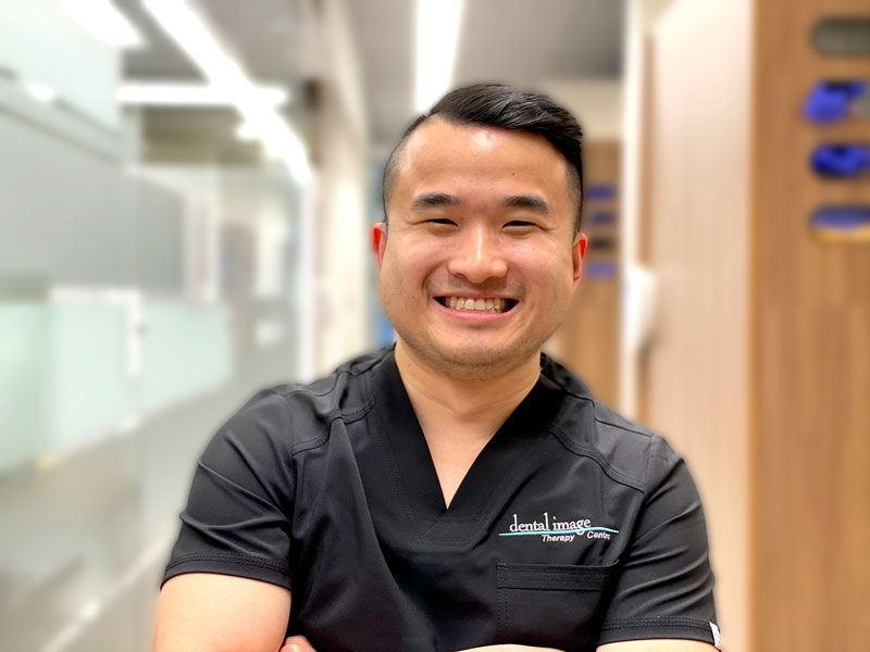 Headshot of Dr. Christopher Bao in the clinic hallway