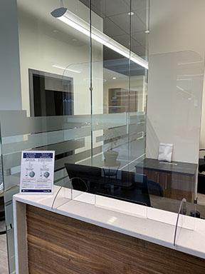 Acrylic barrier at reception St. Vital Centre Clinic