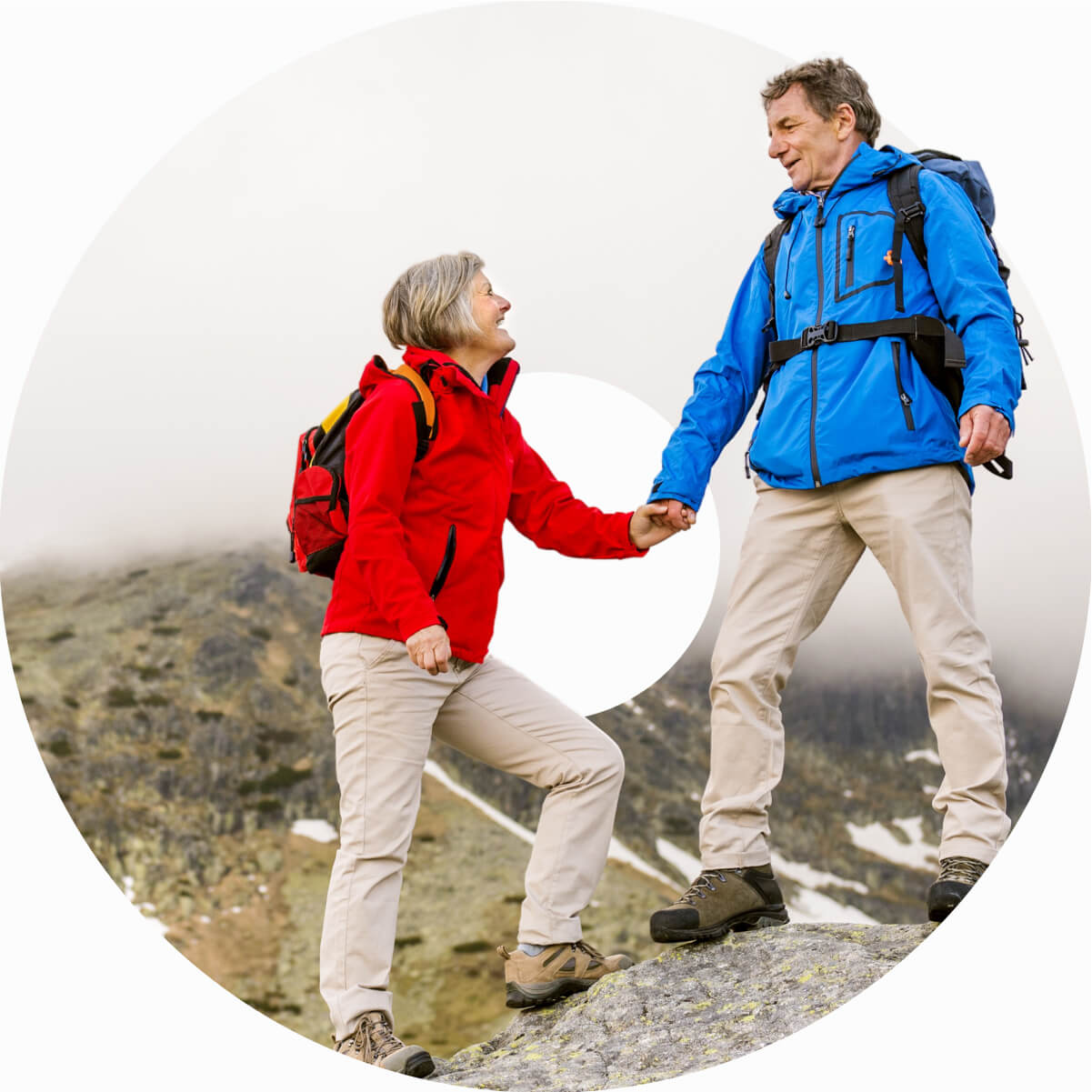 Man and Woman hiking on top of a mountain