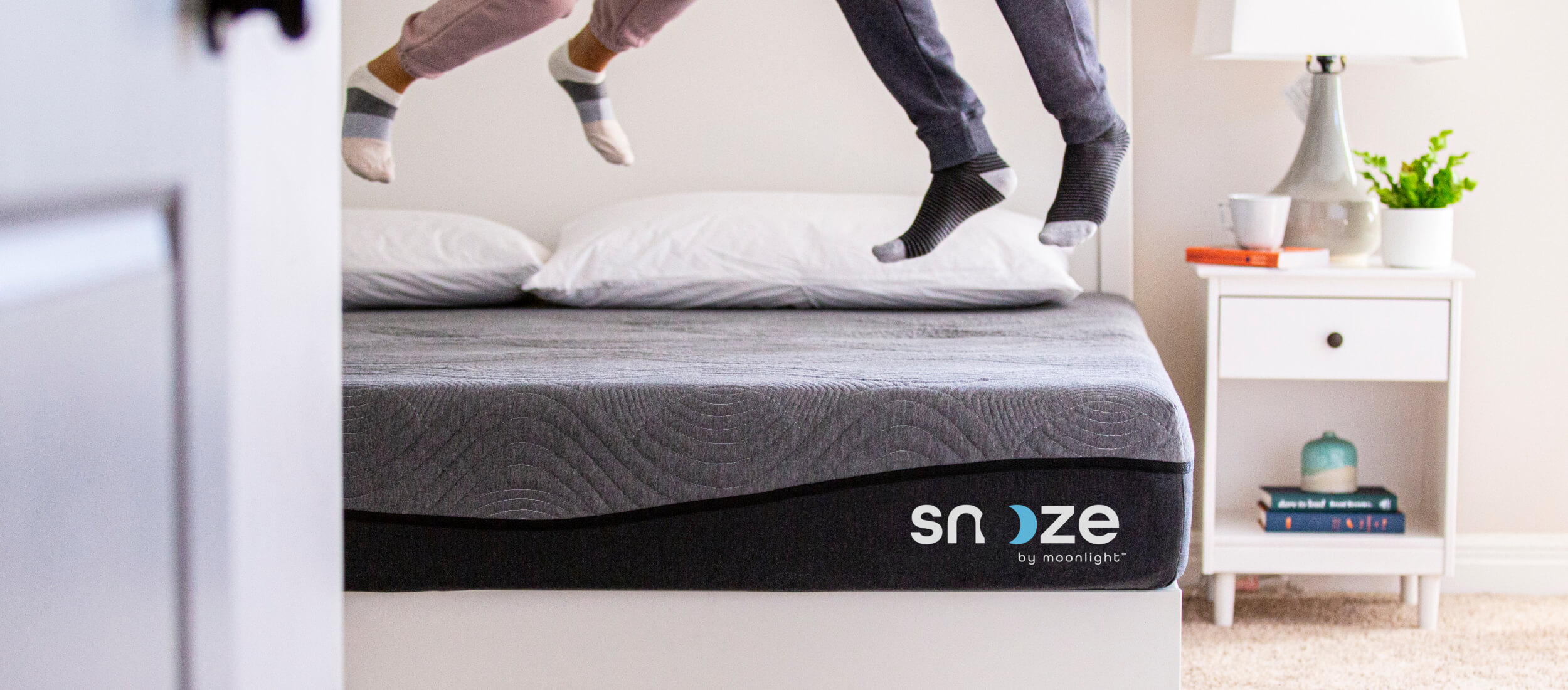 Snooze, Moonlight's new bed-in-a-box brand, designed by Fenix Strategic Design.