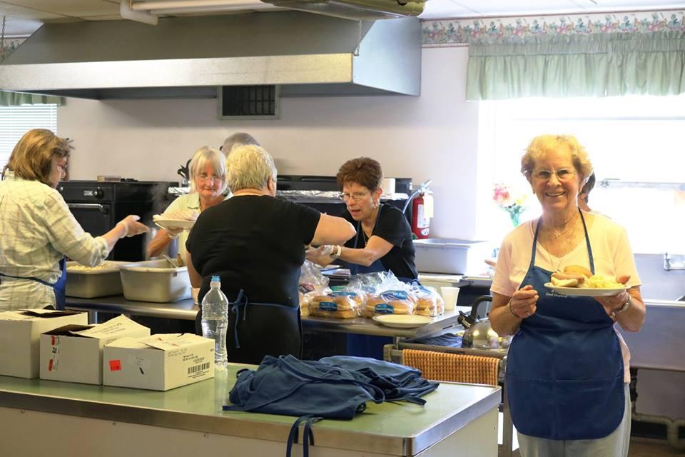 volunteers work in a kitchen