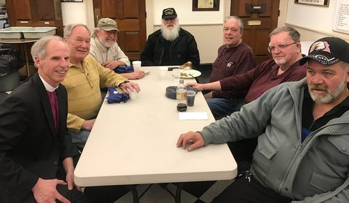 Veterans sit around a table