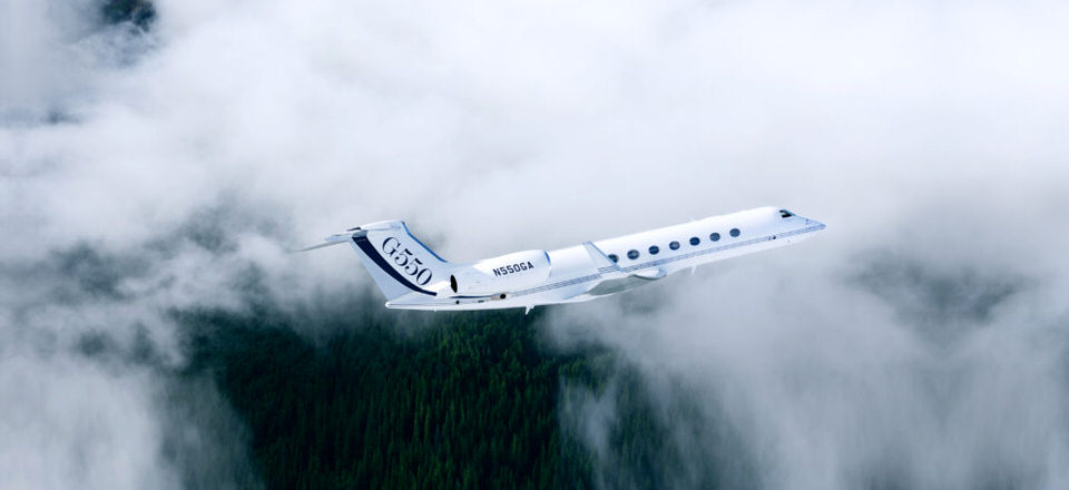 a G550 flying through the clouds