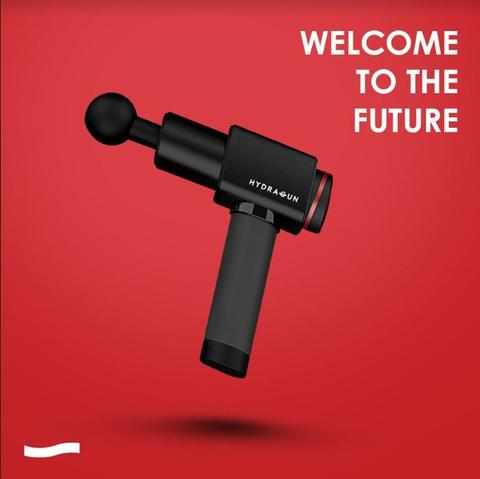 Photo of black Hydragun massage gun against a red background