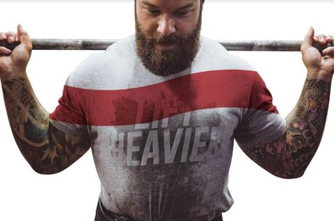 Man in grey weightlifting shirt with Lift Heavier print