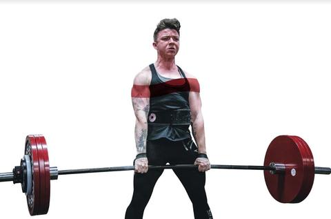 Male weightlifter lifting a red barbell