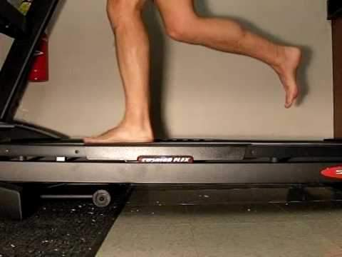 Close up photo of someone's bare feet running on a treadmill
